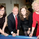 Marie, Bart, Trisha & Helen Arnold adding their names to the Official Ribbon. [Photo by Una Finn]